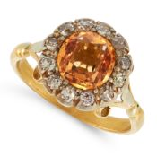 AN ANTIQUE IMPERIAL TOPAZ AND DIAMOND RING, 19TH CENTURY in yellow gold and silver, set with a