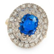 A CEYLON NO HEAT SAPPHIRE AND DIAMOND RING set with a central cushion cut blue sapphire of 2.51