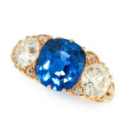 A CEYLON NO HEAT SAPPHIRE AND DIAMOND RING in 18ct yellow gold, set with a cushion cut blue sapphire