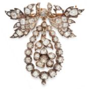 AN ANTIQUE DIAMOND PENDANT / BROOCH in yellow gold and silver, in foliate design, set with old cut