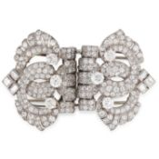 A VINTAGE DIAMOND DOUBLE CLIP BROOCH, CARTIER in white gold or platinum, in open framework design,