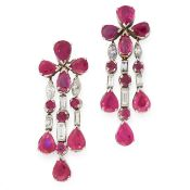 A PAIR OF RUBY AND DIAMOND EARRINGS in 18ct white gold, each designed as a cluster of four pear