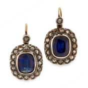 A PAIR OF SYNTHETIC SAPPHIRE AND DIAMOND CLUSTER EARRINGS in yellow gold and silver, each comprising