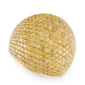 A YELLOW DIAMOND BOMBE RING in 18ct yellow gold, pave set with round cut yellow diamonds totalling