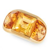 A VINTAGE CITRINE RING in yellow gold, set with a central step cut citrine between two fancy cut
