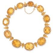 AN ANTIQUE CITRINE RIVIERE NECKLACE, 19TH CENTURY in yellow gold, comprising a row of eleven