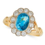 AN AQUAMARINE AND DIAMOND CLUSTER RING in 18ct yellow gold, set with an oval cut aquamarine of 1.