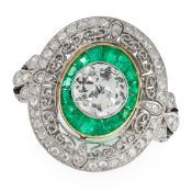 AN ANTIQUE EMERALD, DIAMOND AND ONYX TARGET RING set with a transitional cut diamond of 0.85