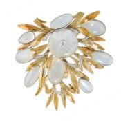 A VINTAGE DIAMOND AND MOONSTONE BROOCH / PENDANT in 18ct yellow gold, set with a central polished