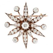 AN ANTIQUE DIAMOND STAR BROOCH / PENDANT, 19TH CENTURY in yellow gold and silver, designed as a