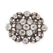 AN ANTIQUE DIAMOND BROOCH in yellow gold and silver, set to the centre with a cluster of seven old