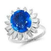 A CEYLON NO HEAT SAPPHIRE AND DIAMOND DRESS RING set with a cushion cut blue sapphire of 4.87 carats
