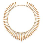 AN ANTIQUE FRINGE RIVIERE NECKLACE, 19TH CENTURY in yellow gold, in the Etruscan revival manner, the