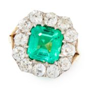 A COLOMBIAN EMERALD AND DIAMOND DRESS RING in yellow gold and silver, set with an emerald cut
