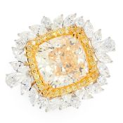 A YELLOW DIAMOND AND DIAMOND DRESS RING in 18ct white and yellow gold, set with a cushion cut