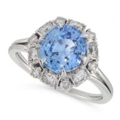 A SAPPHIRE AND DIAMOND CLUSTER RING comprising of an oval cut sapphire of 2.80 carats in a border of