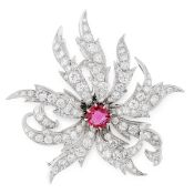 A RUBY AND DIAMOND BROOCH designed as a stylised flower, set at the centre with a cushion cut ruby