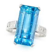 AN AQUAMARINE AND DIAMOND DRESS RING set with an emerald cut aquamarine of 12.58 carats, accented by