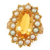 AN ANTIQUE IMPERIAL TOPAZ AND PEARL DRESS RING, 19TH CENTURY in yellow gold, set with an oval cut