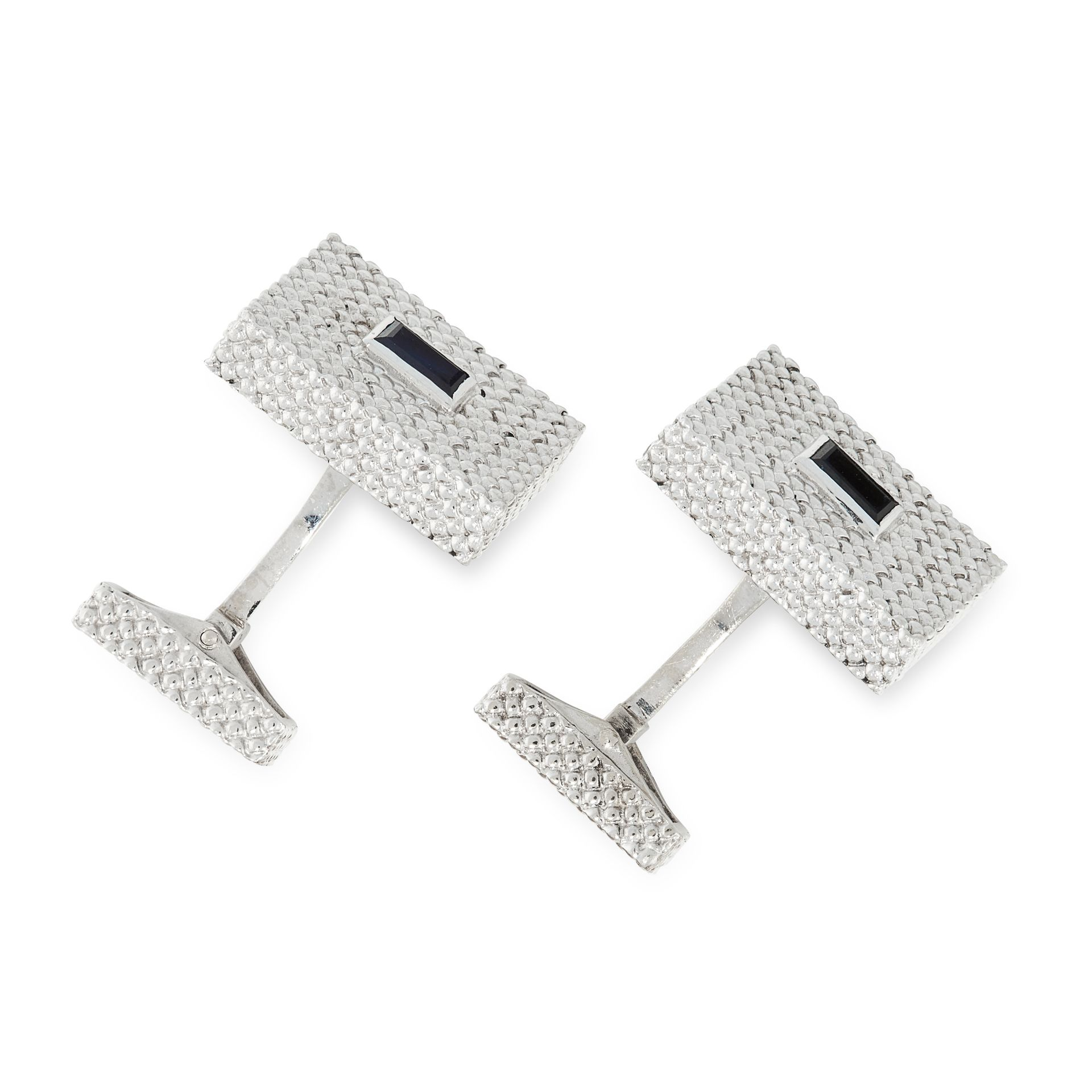 A PAIR OF SAPPHIRE CUFFLINKS, FRED in 18ct white gold, the rectangular textured faces set with