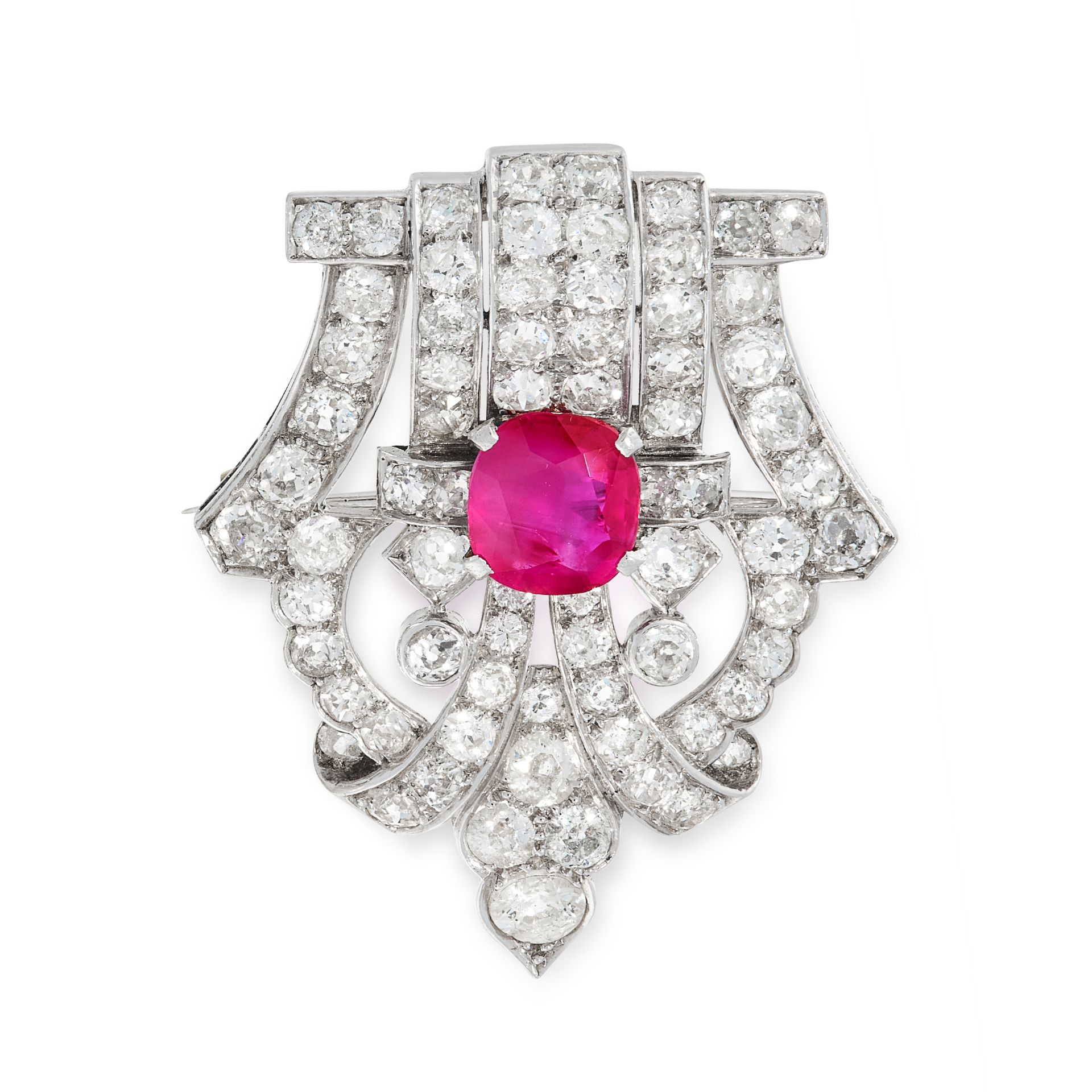 A RUBY AND DIAMOND BROOCH, EARLY 20TH CENTURY of shield design, set with a central cushion cut