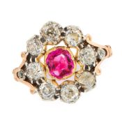 AN ANTIQUE RUBY AND DIAMOND DRESS RING in high carat yellow gold and silver, set with a cushion