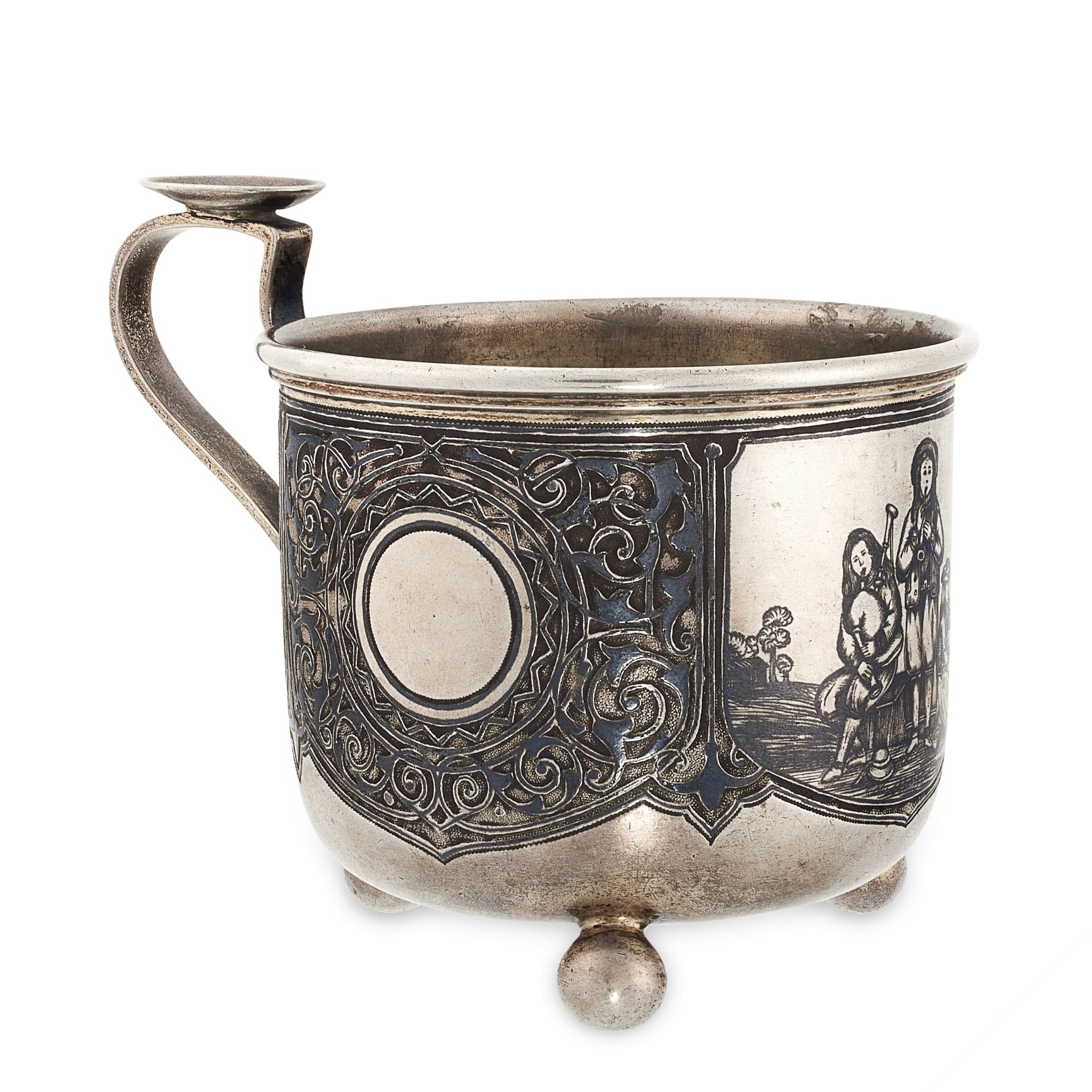 AN ANTIQUE IMPERIAL RUSSIAN NIELLO TEA GLASS HOLDER, MOSCOW 1870 in 84 zolotnik silver, the body