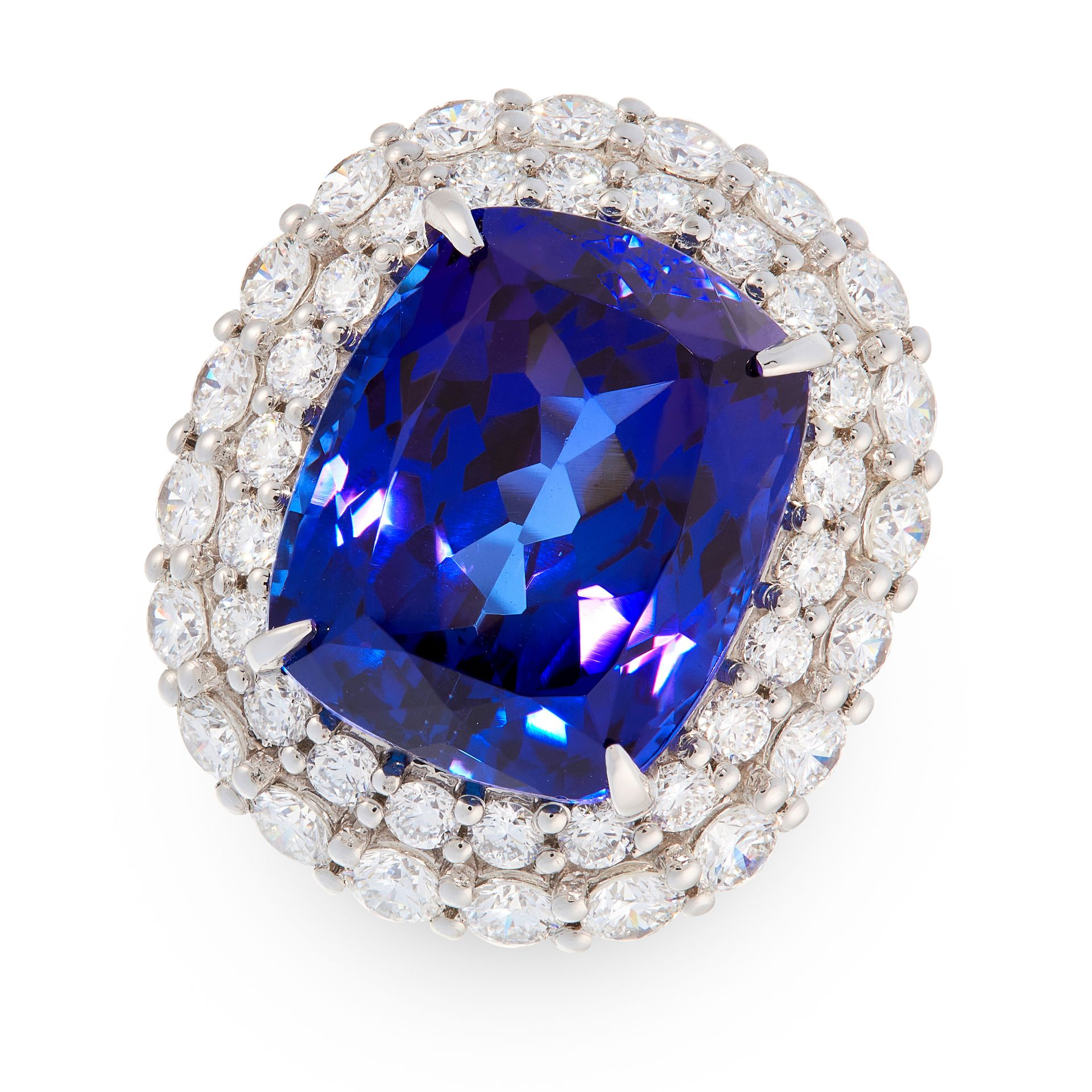 AN EXCEPTIONAL TANZANITE AND DIAMOND DRESS RING in platinum, set with a cushion cut tanzanite of