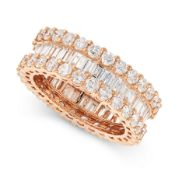 A DIAMOND ETERNITY BAND RING in 18ct gold, comprising a central row of baguette cut diamonds