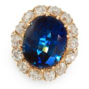 AN IMPORTANT SAPPHIRE AND DIAMOND DRESS RING in 18ct yellow gold, set with a cushion cut sapphire of