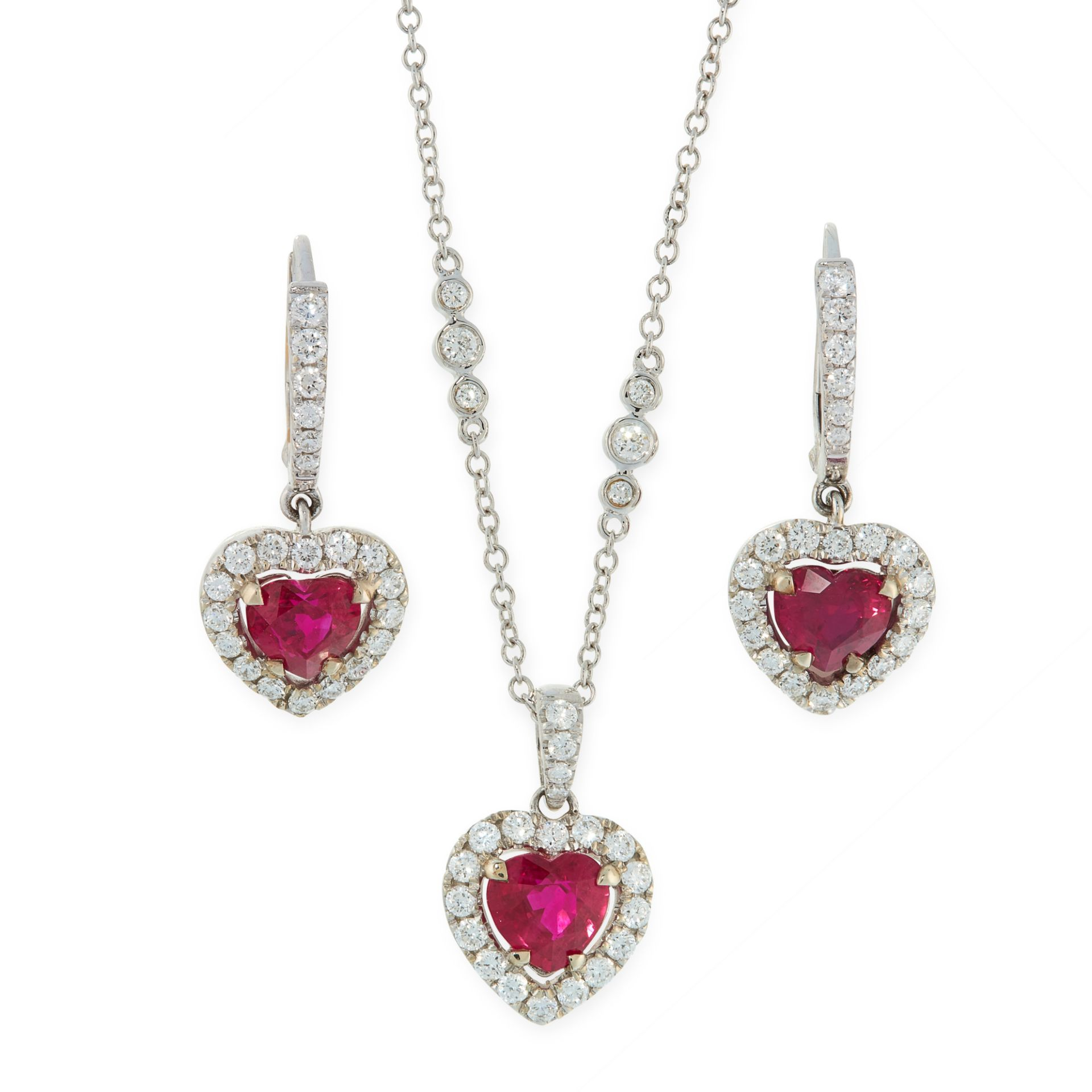 A RUBY AND DIAMOND PENDANT, CHAIN AND EARRINGS SUITE in 18ct white gold, each set with a heart