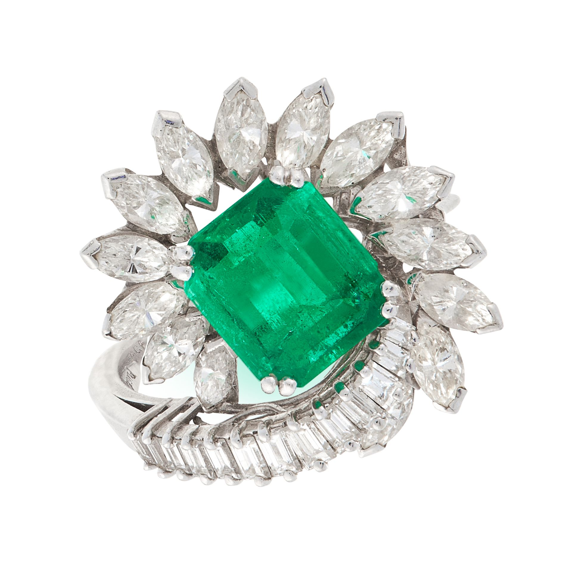 AN EMERALD AND DIAMOND DRESS RING, PIAGET in platinum, set with an emerald cut emerald of 1.64