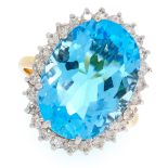 A BLUE TOPAZ AND DIAMOND CLUSTER RING in 18ct yellow gold, set with an oval cut topaz in a cluster