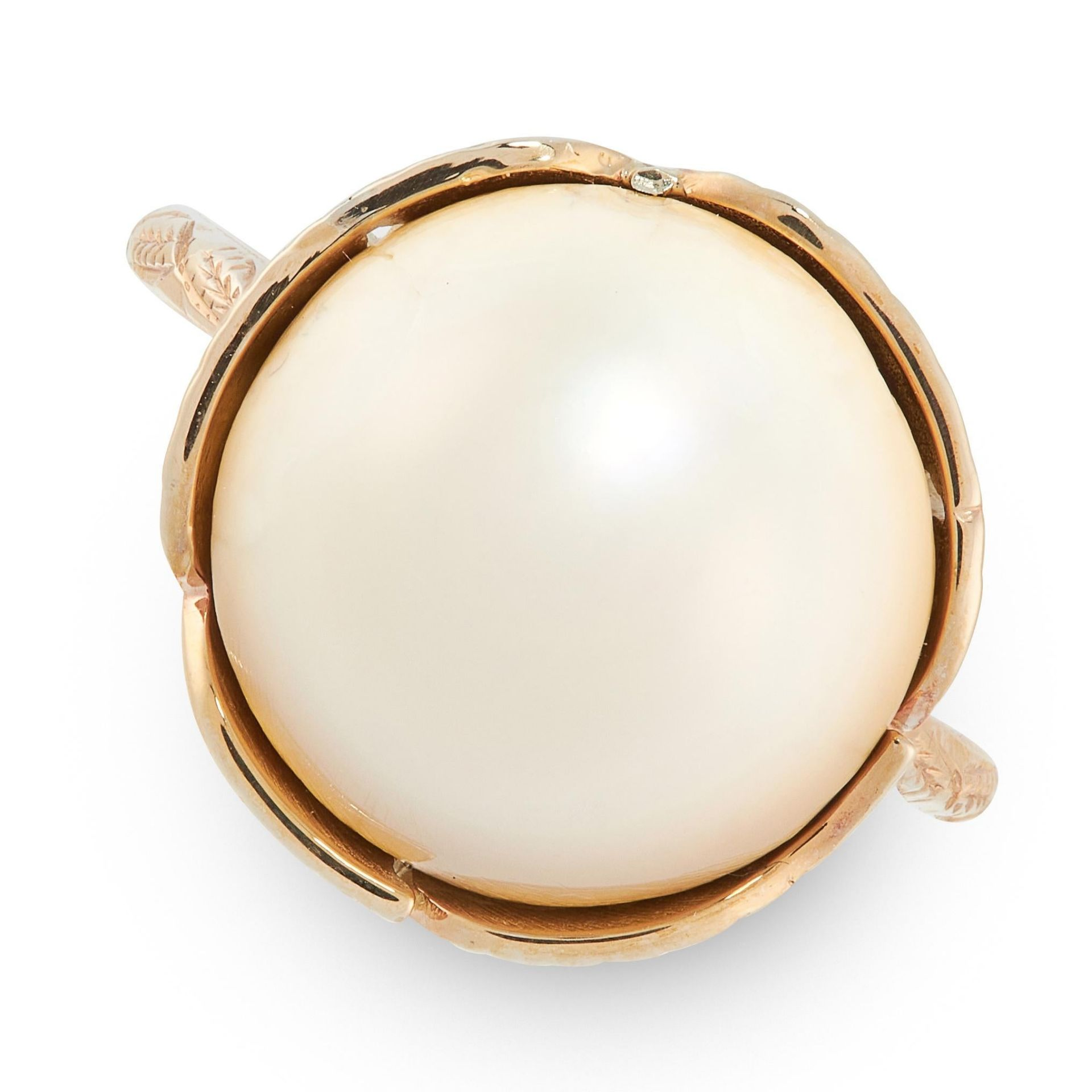 A NATURAL PEARL DRESS RING in yellow gold, set with a circular natural blister pearl of 13.81mm,