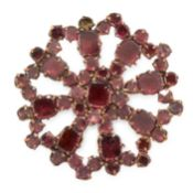 AN ANTIQUE GARNET BROOCH set throughout with round and cushion shaped flat cut garnets, unmarked,
