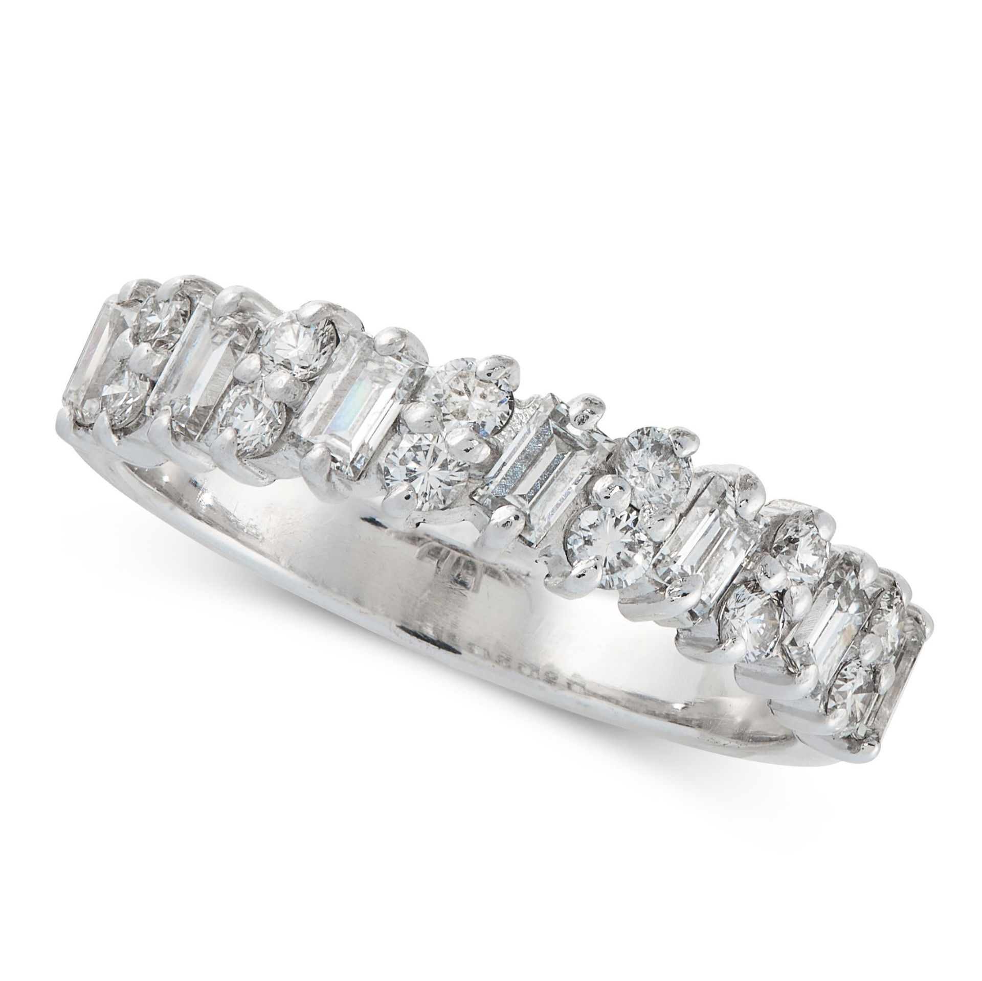 A DIAMOND ETERNITY RING in 18ct white gold, set with alternating baguette and round cut diamonds