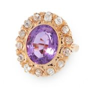 AN ANTIQUE AMETHYST AND DIAMOND DRESS RING, CIRCA 1900 in high carat yellow gold, set with an oval