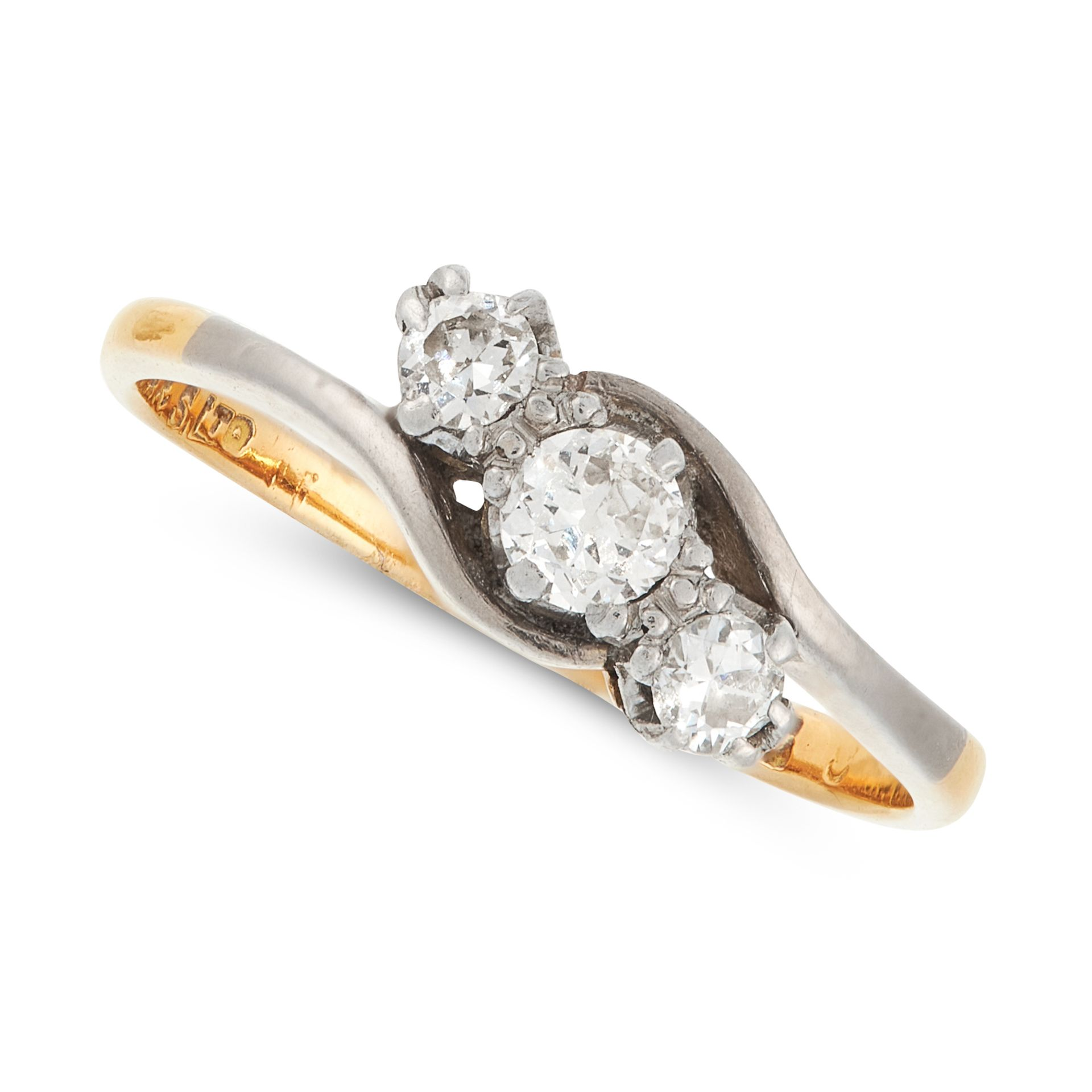 A DIAMOND THREE STONE RING in yellow gold, the twisted shank is set with a trio of old and round cut