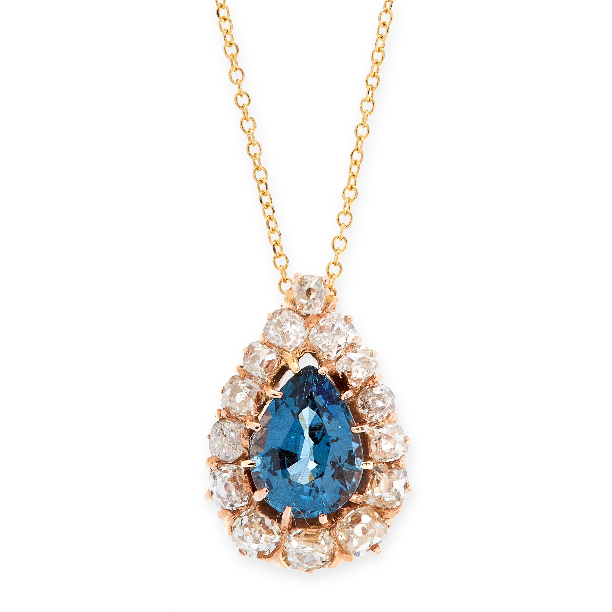 AN ANTIQUE SAPPHIRE AND DIAMOND PENDANT AND CHAIN in 18ct yellow gold, the pendant set with a pear