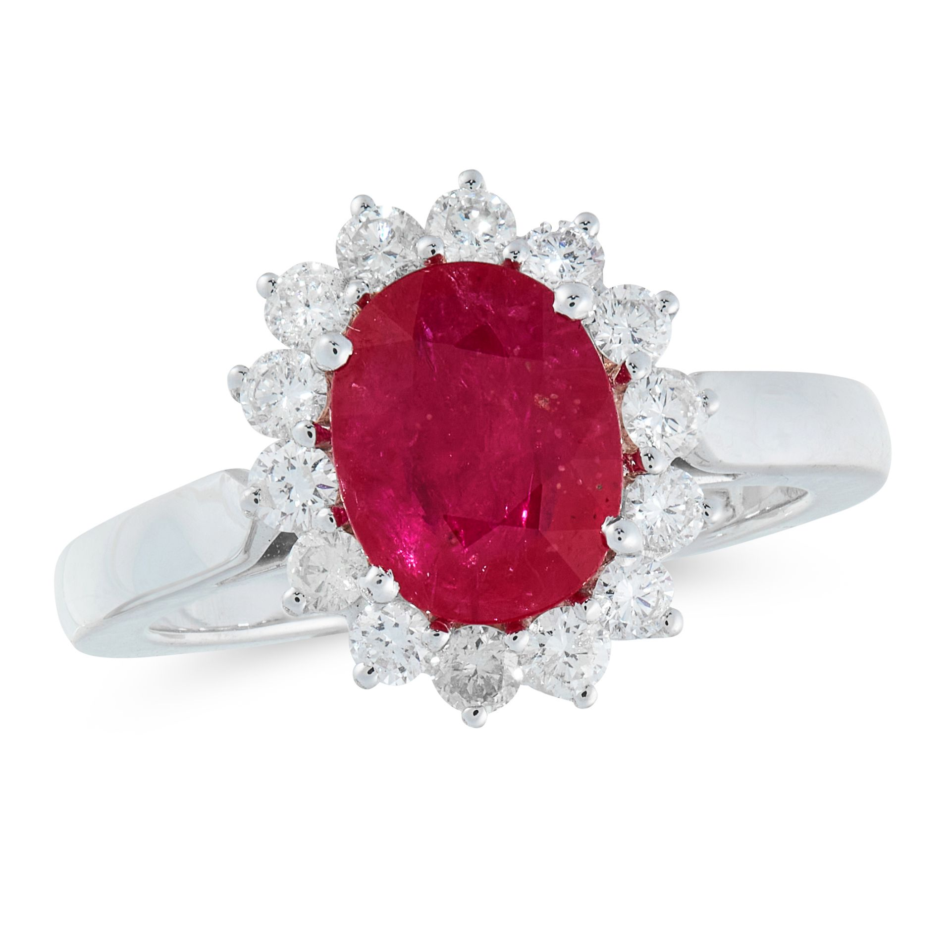 A RUBY AND DIAMOND CLUSTER RING in 18ct white gold, set with an oval cut ruby of 2.08 carats in a