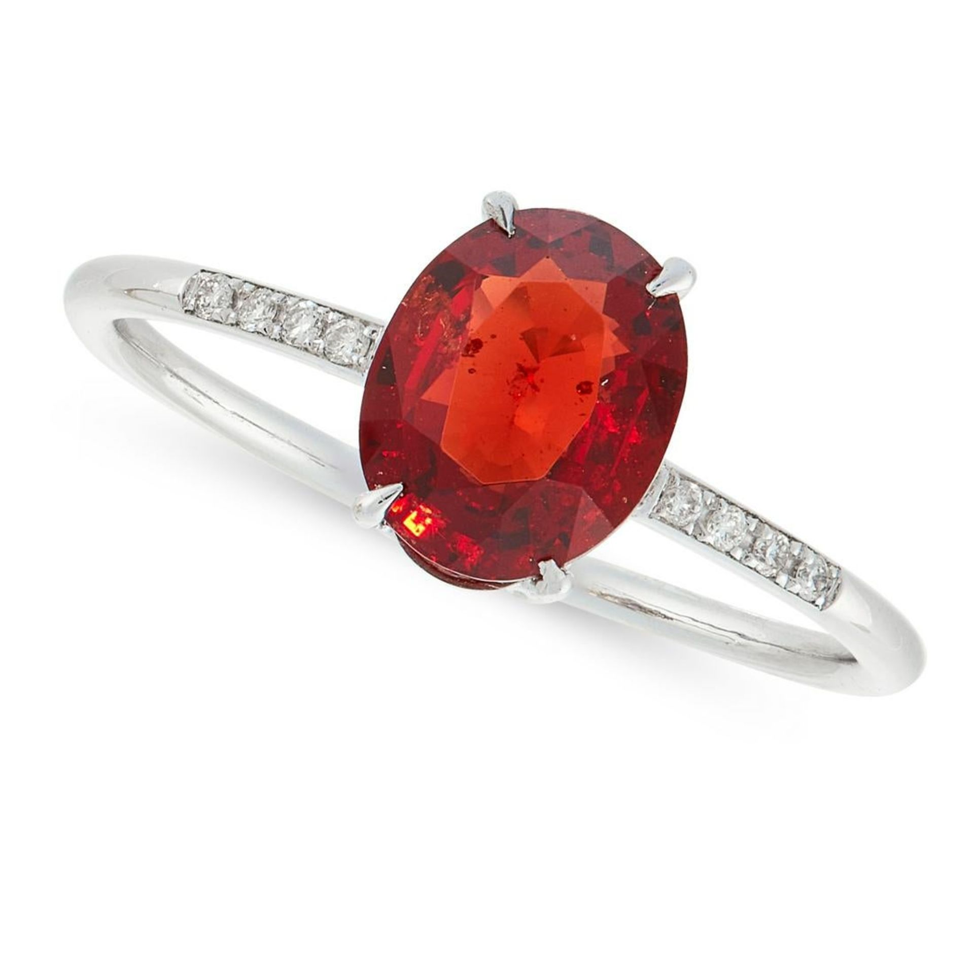 A RED SPINEL AND DIAMOND DRESS RING in 18ct white gold, set with an oval cut red spinel of 1.33