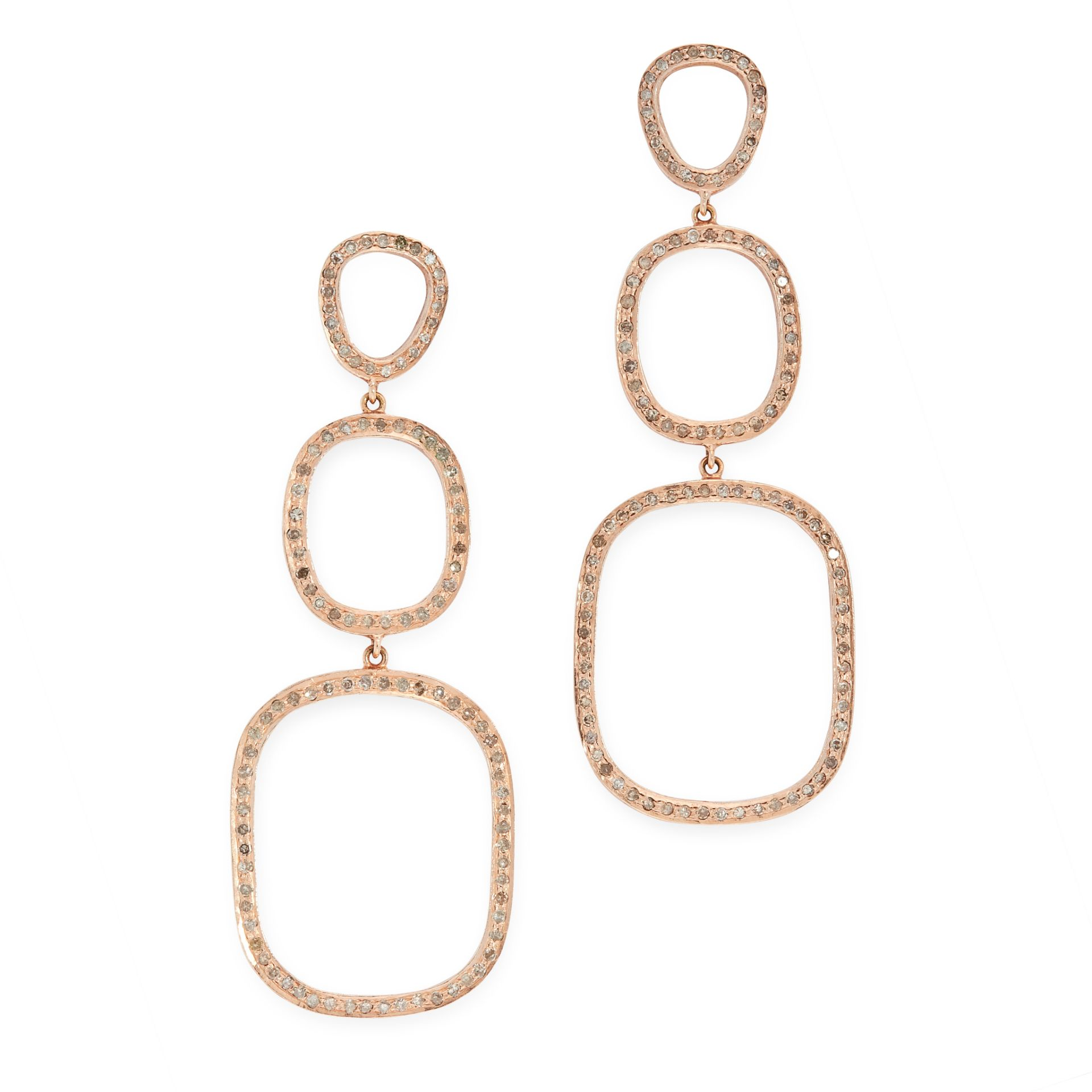 A PAIR OF DIAMOND DROP EARRINGS in the form of three graduated oval drops, set with round cut