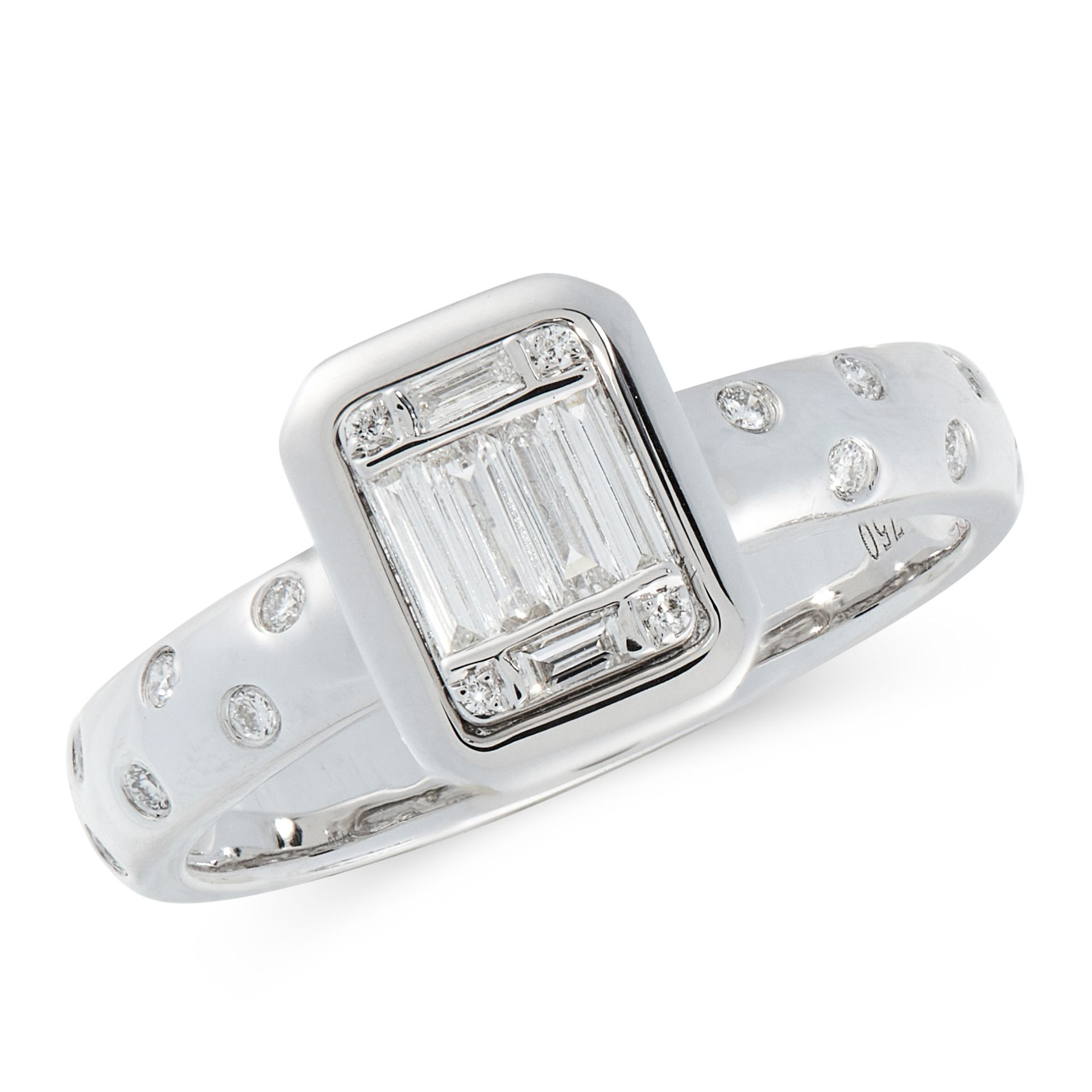 A DIAMOND DRESS RING in 18ct white gold, comprising of a band set with staggered round cut diamonds,