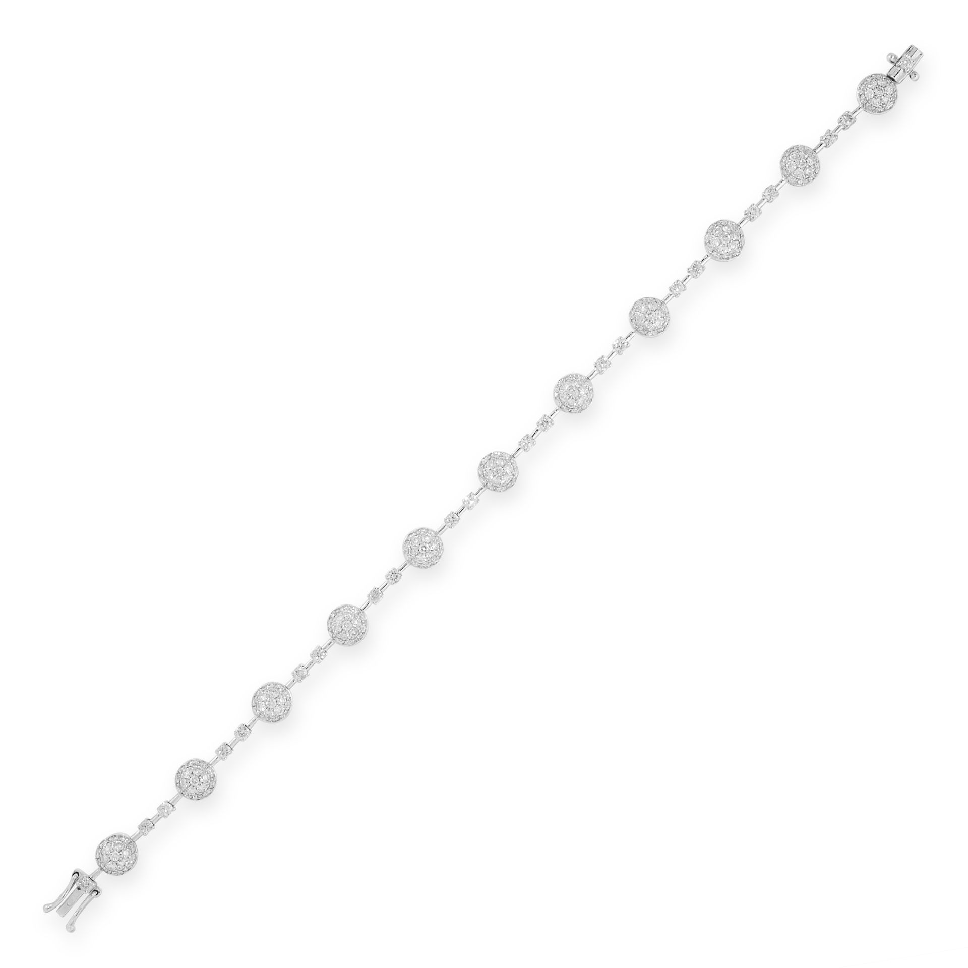 A DIAMOND LINE BRACELET in 18ct white gold, comprising of eleven circular links set with round cut
