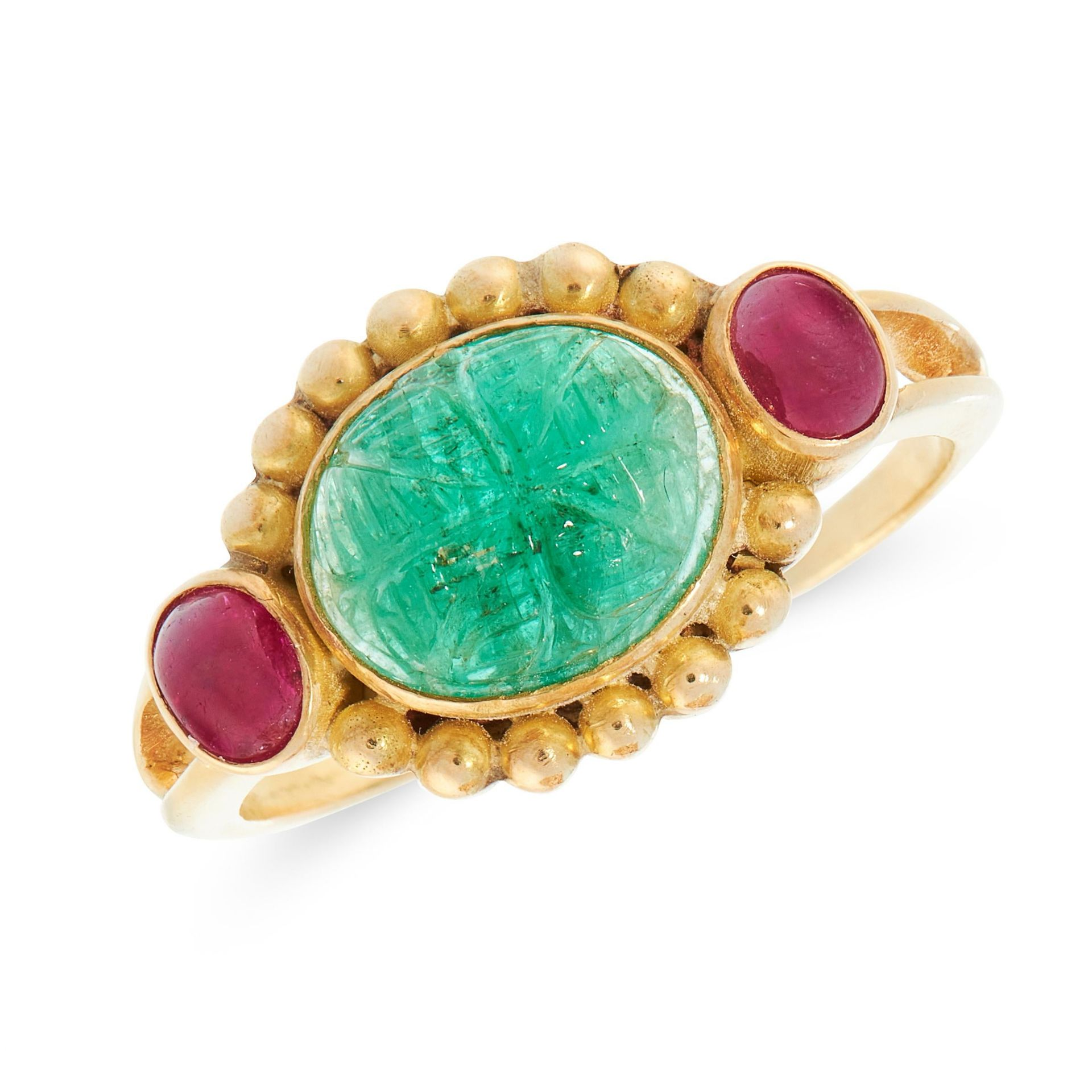 A MUGHAL CARVED EMERALD AND RUBY DRESS RING in 18ct yellow gold, set with an oval cabochon emerald