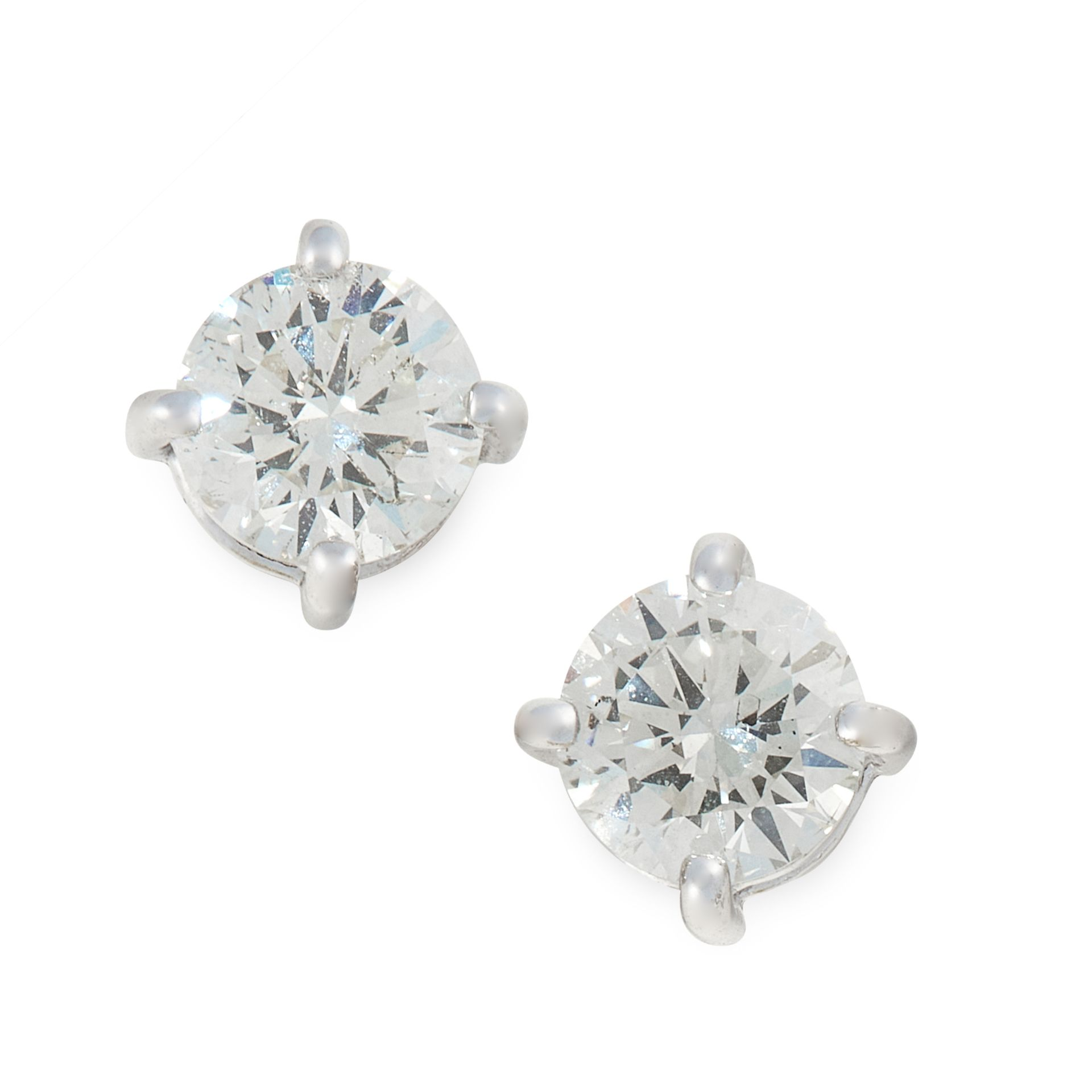 A PAIR OF DIAMOND STUD EARRINGS in 18ct white gold, set with a round cut diamond totalling 1.05