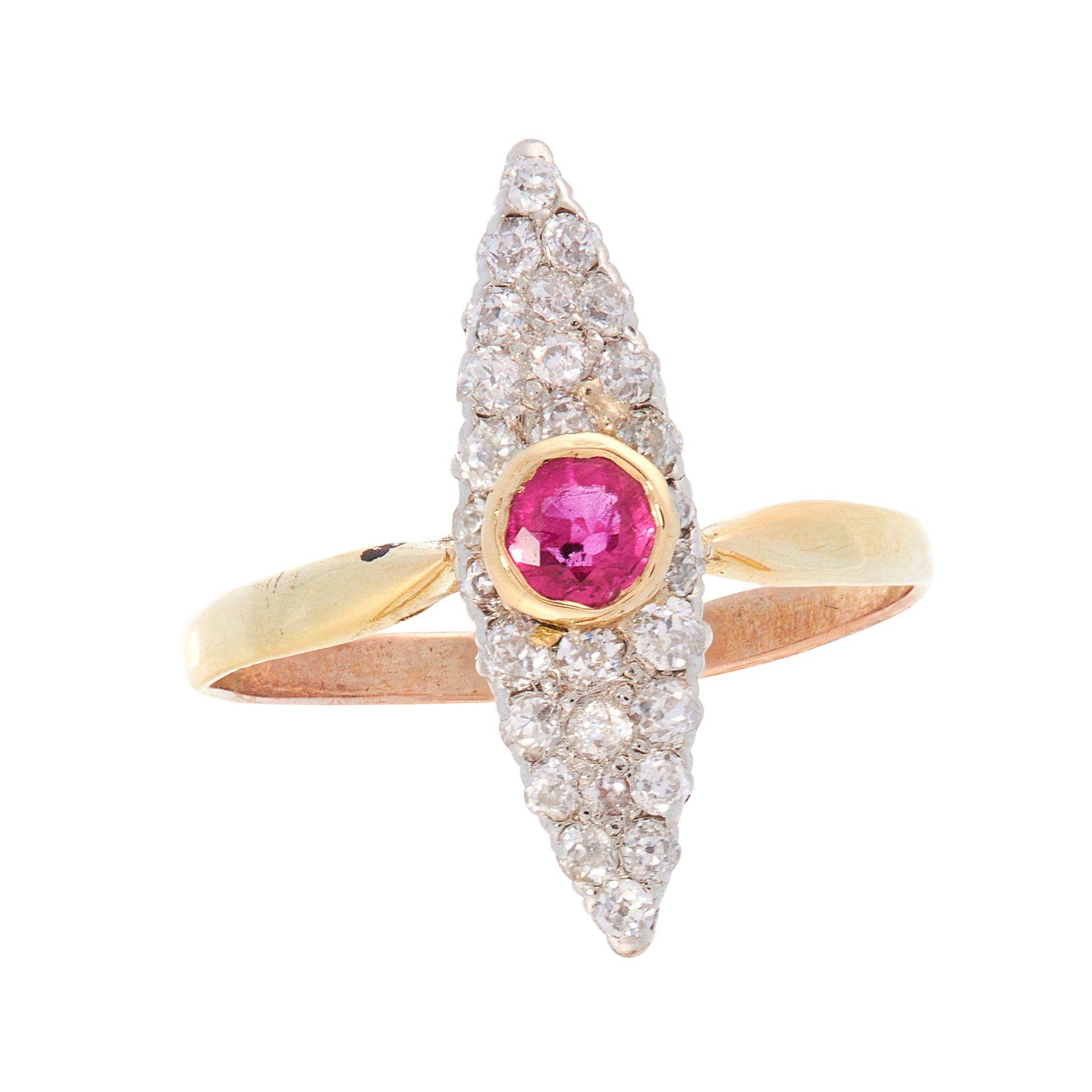 A RUBY AND DIAMOND DRESS RING in high carat yellow gold, the marquise shaped face set with a round