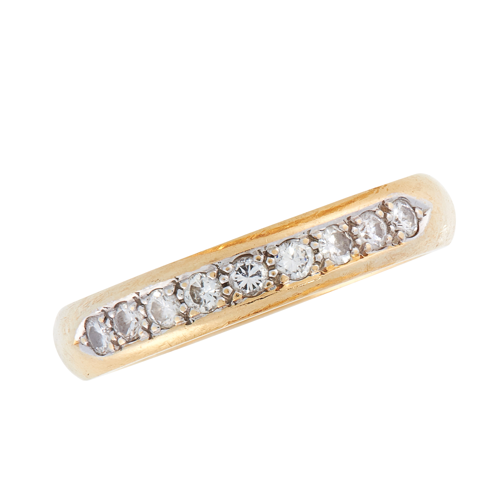 A VINTAGE DIAMOND HALF ETERNITY RING in 18ct yellow gold, the band set with nine round cut diamonds,