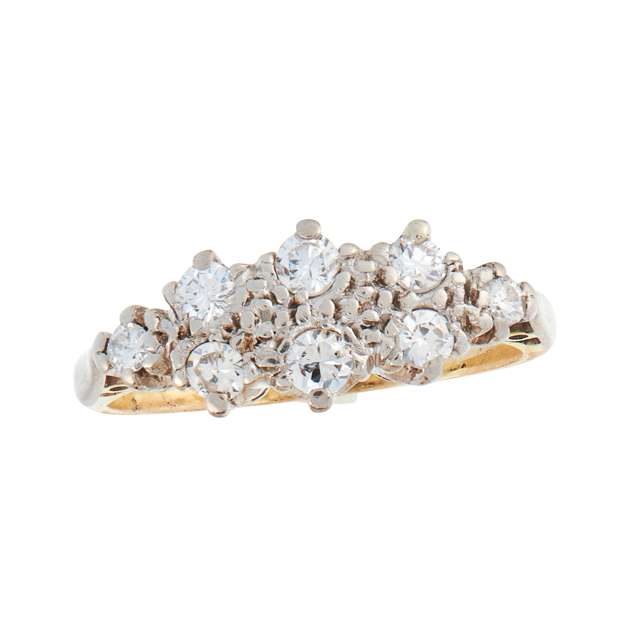 A DIAMOND DRESS RING, CIRCA 1940 in 18ct yellow gold and platinum, set with eight graduated round