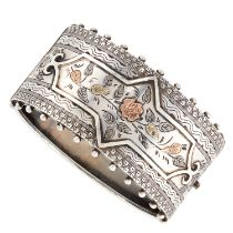AN ANTIQUE VICTORIAN CUFF BANGLE, 1883 in sterling silver and gold, with beaded borders and engraved